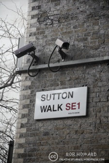 two security cameras by a London street sign