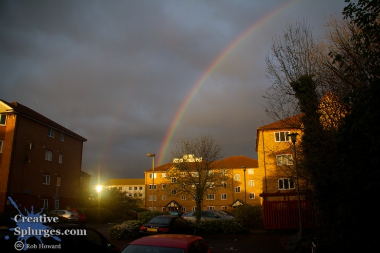 rainbow over houses