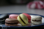 close up of colourful macaroons on a plate