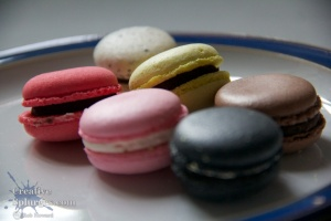 coloured macaroons on a plate