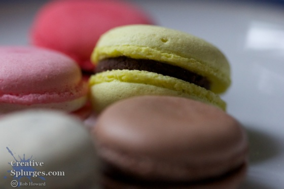 macro shot of coloured macaroons on a plate