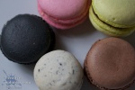 top-down shot of a circle of colourful macaroons