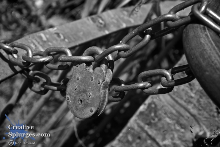 monochrome closeup of a padlock and chain