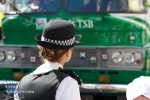 A police officer eyes up the Lloyds TSB vehicle.
