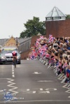 Lizzy Armitstead, silver medal winner in the women's road race, is greeted by a mass of waving Union flags.