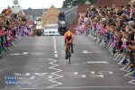 A Dutch rider makes her way over the bridge.