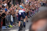 Chris Froome rides past a screaming crowd.