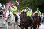 Some mounted police keep the peace.