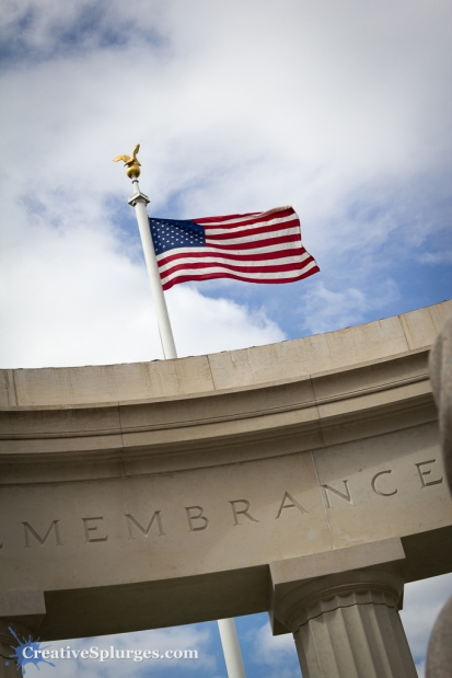 The American flag flies over the Chapel at St Mihiel American Cemetery, France,