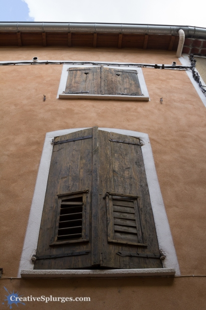 A set of windows in a building in Moustiers-Sainte-Marie, France